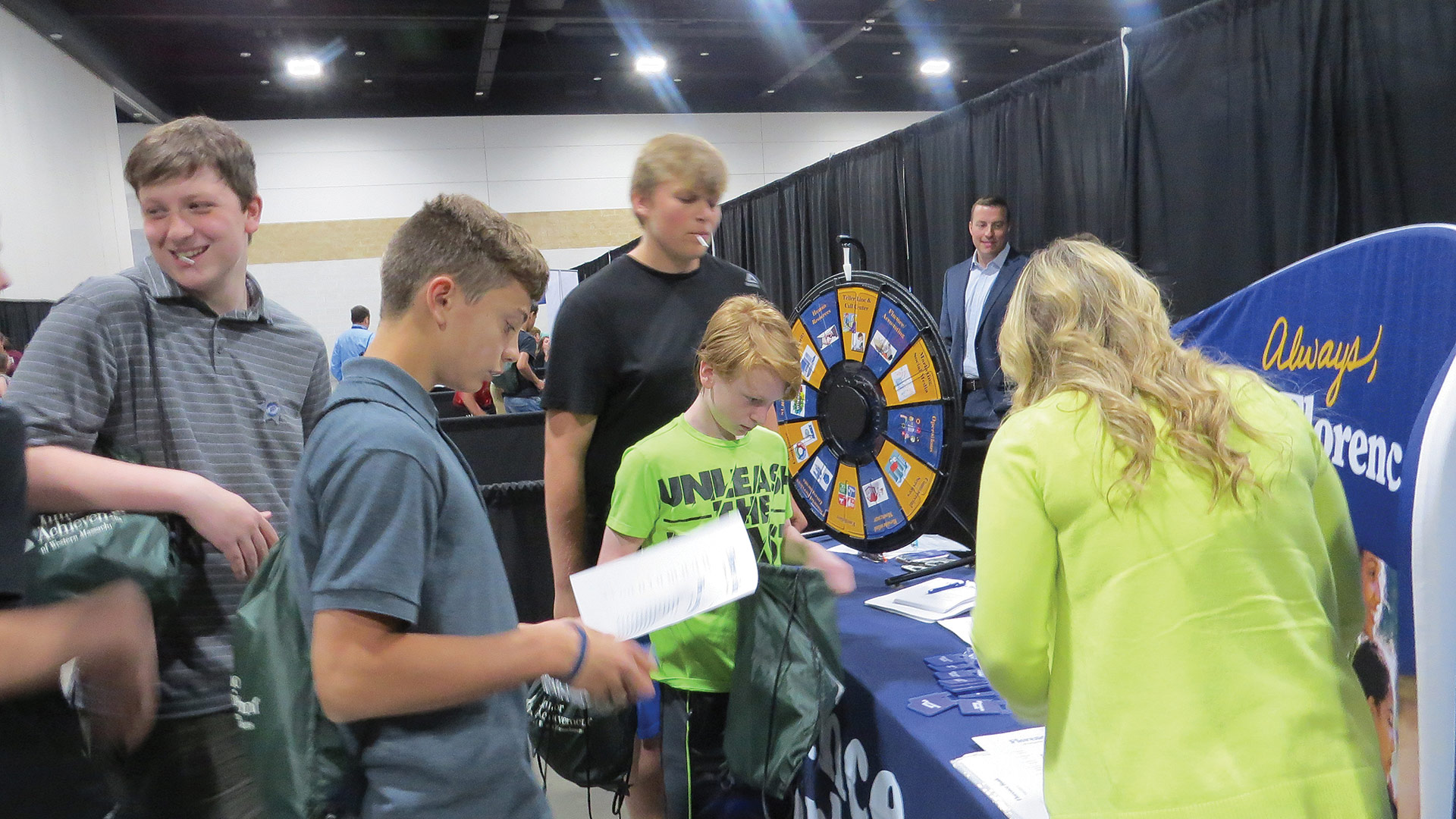 students take part in the activities at the Florence Bank booth
