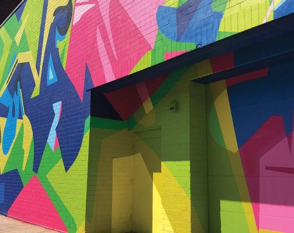 The East Columbus parking garage after being colorfully decorated by artist Wane One from the Bronx, N.Y.