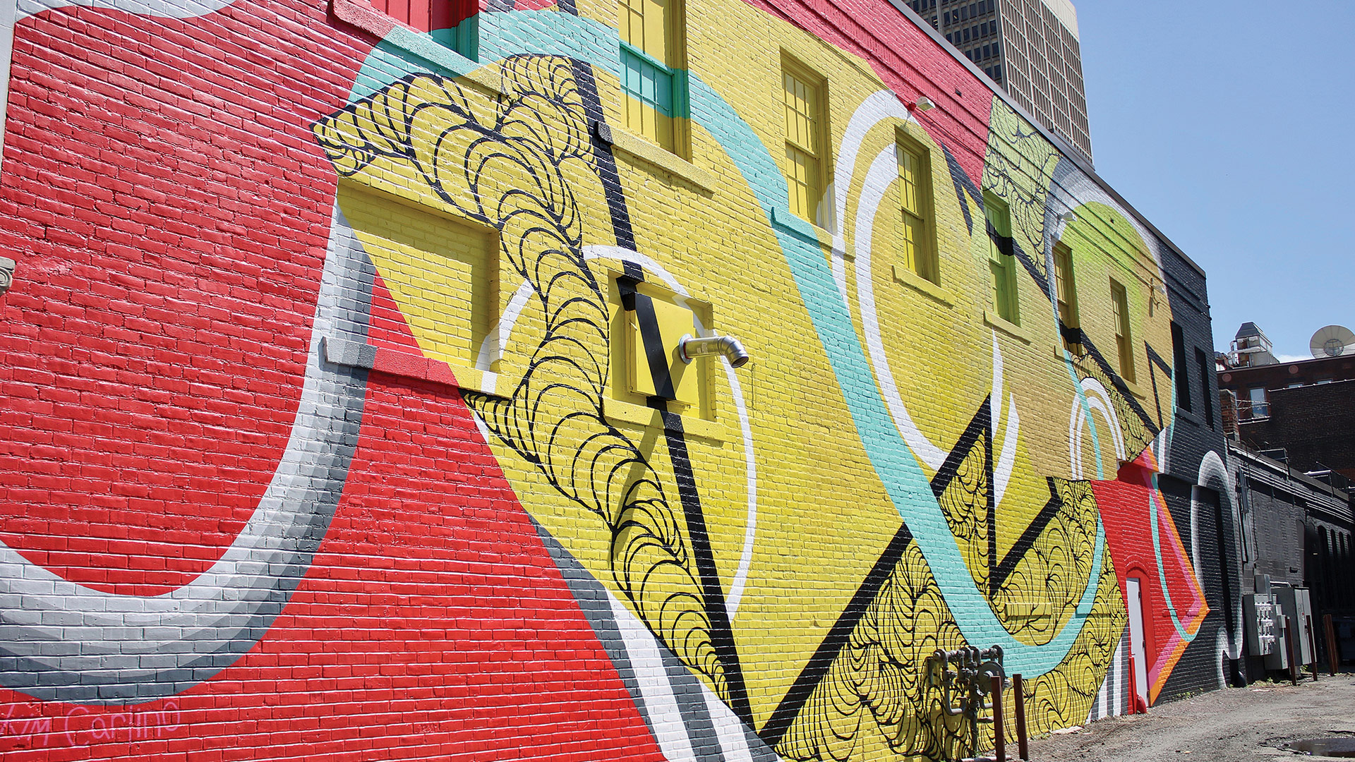 Kim Carlino's mural at 8-12 Stearns Square is a product of her love for creating illusion and disillusion of space in abstract form.