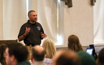 Joe Hileman of Blue-U Defense addresses the audience gathered at the recent seminar on workplace violence.