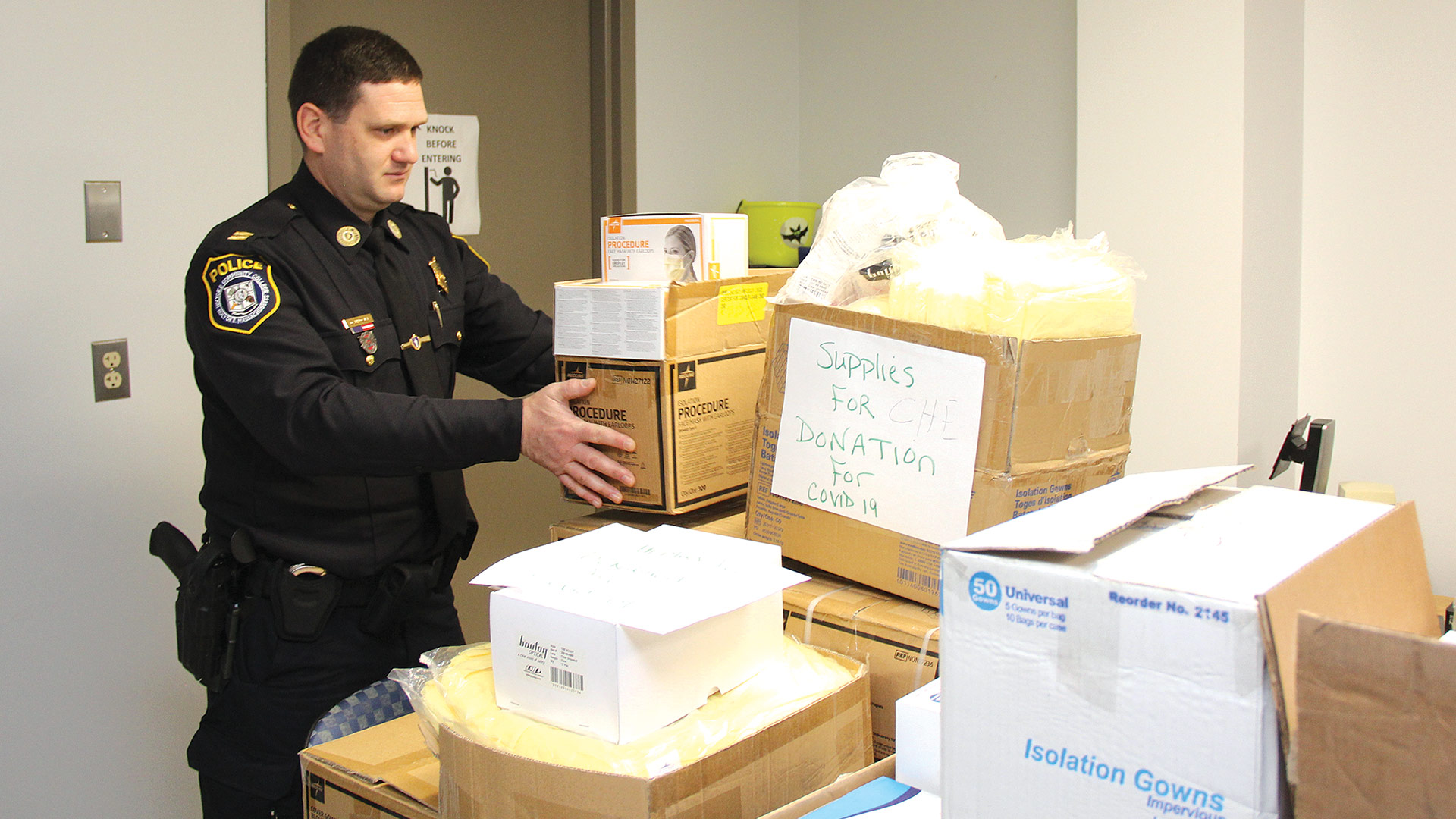 HCC Police Captain Dale Brown stacks boxes