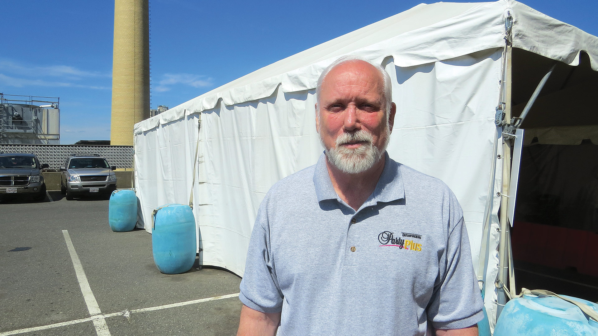 Greg Jerome stands by one of the tents