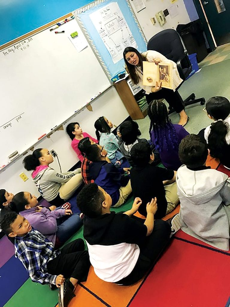 Pia Kumar, seen here reading to children at the Morgan School in Holyoke