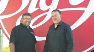 Dan Renzi, left, and his brother, John, stand in front of a new sign made for Big Y.