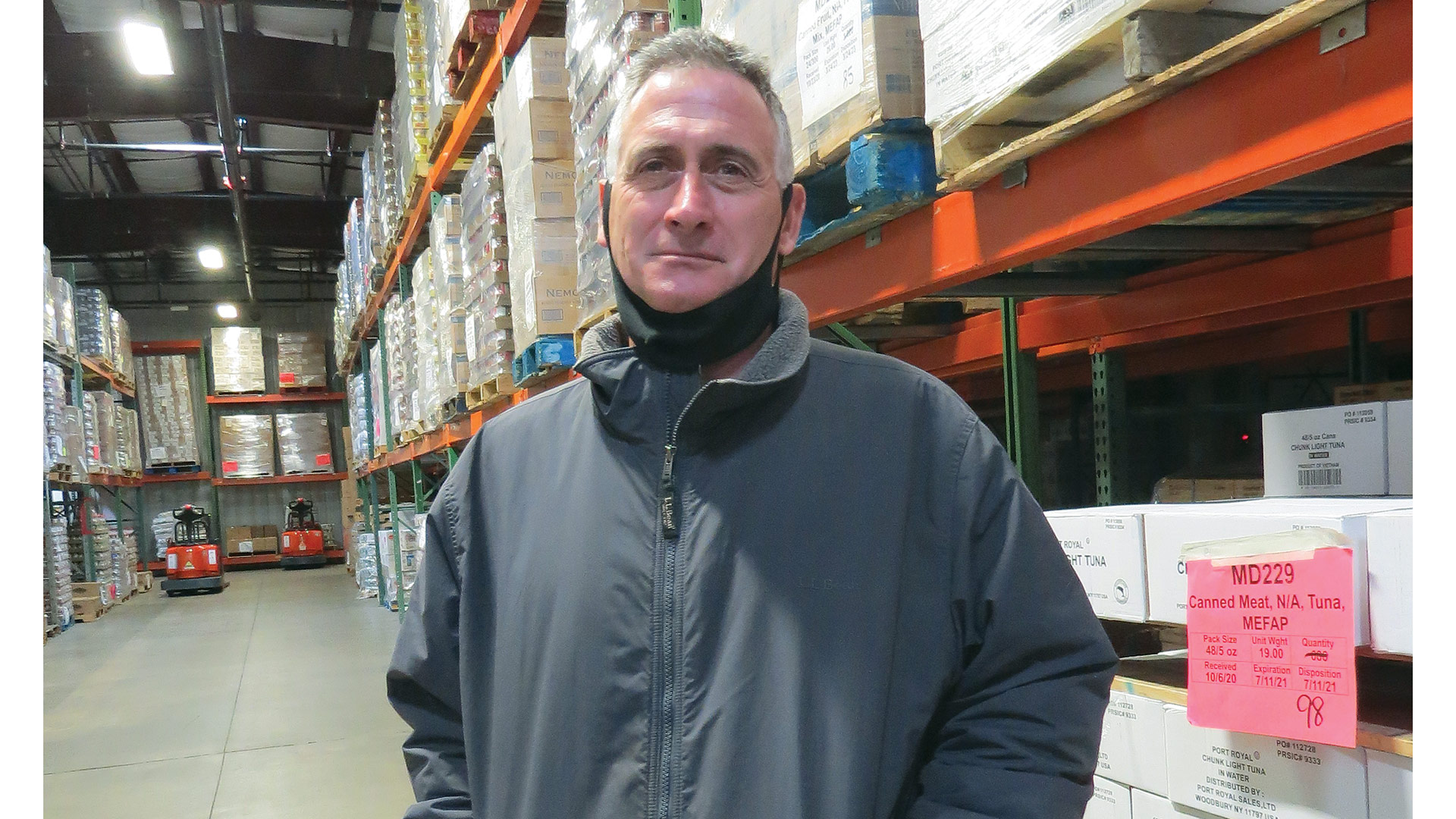 Andrew Morehouse stands in the warehouse at the Food Bank's complex in Hatfield.