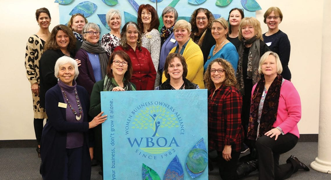 The WBOA team with a mural