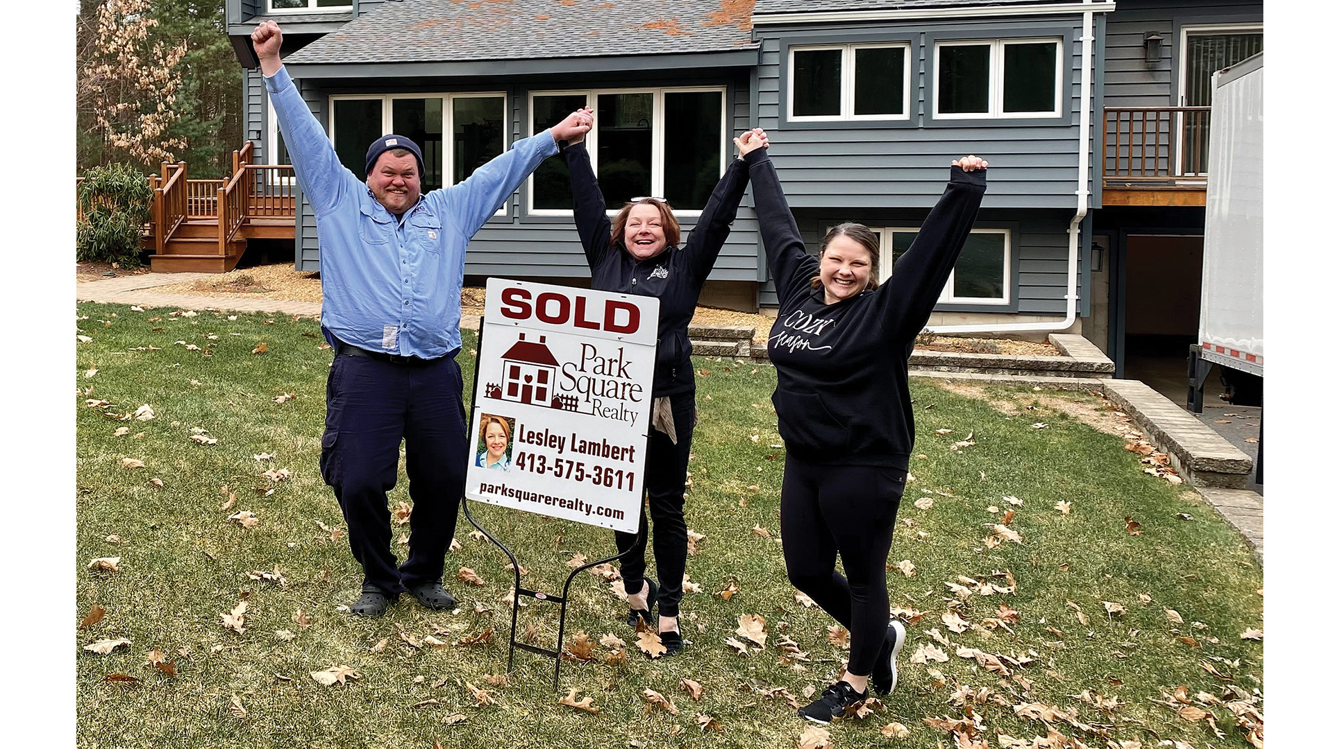 Lesley Lambert (center, celebrating another sale)
