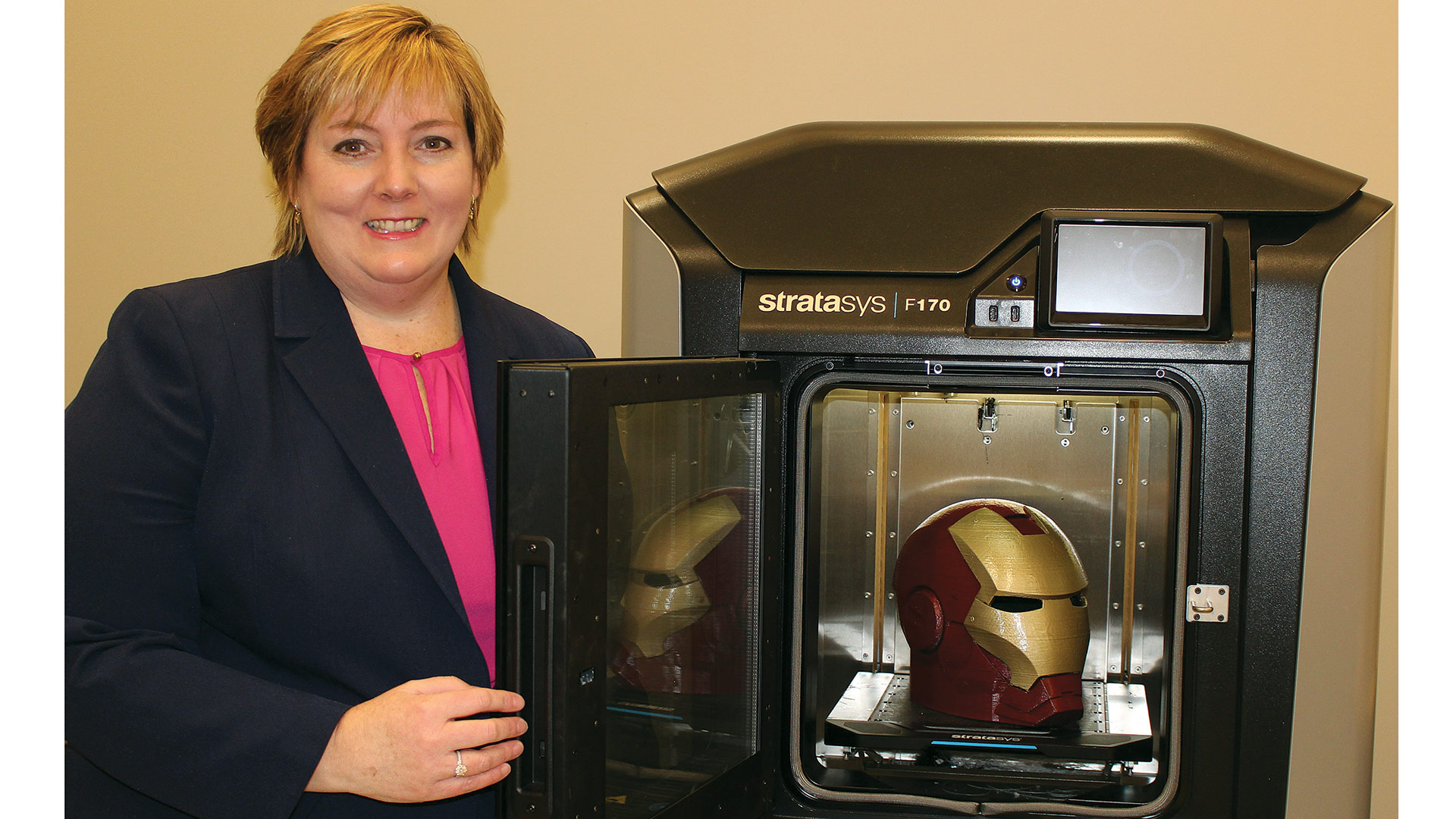 Mary Bidwell with one of the center's 3-D printers.
