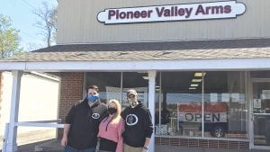 From left, Michael Meunier, owner Kendall Knapik, and Orpheus Barrows from Pioneer Valley Arms.
