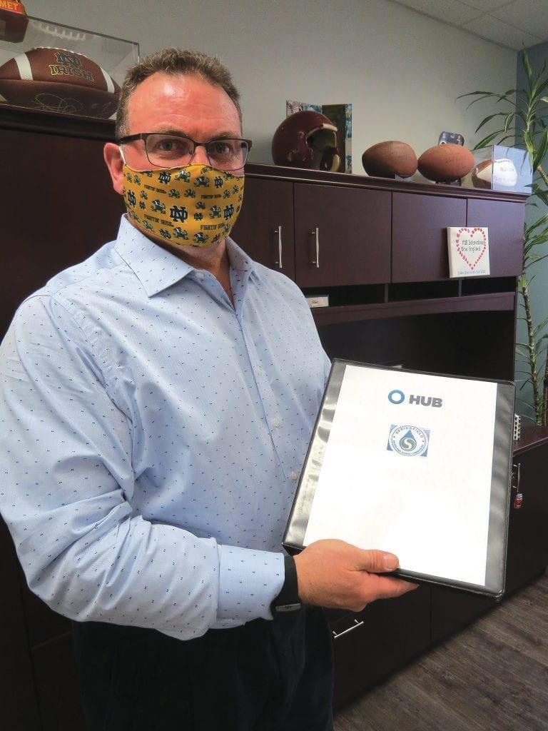 Timm Marini holds up an 'insurance bible'