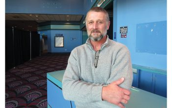 Dave Thompson stands in the lobby of the former Cinemark Theaters