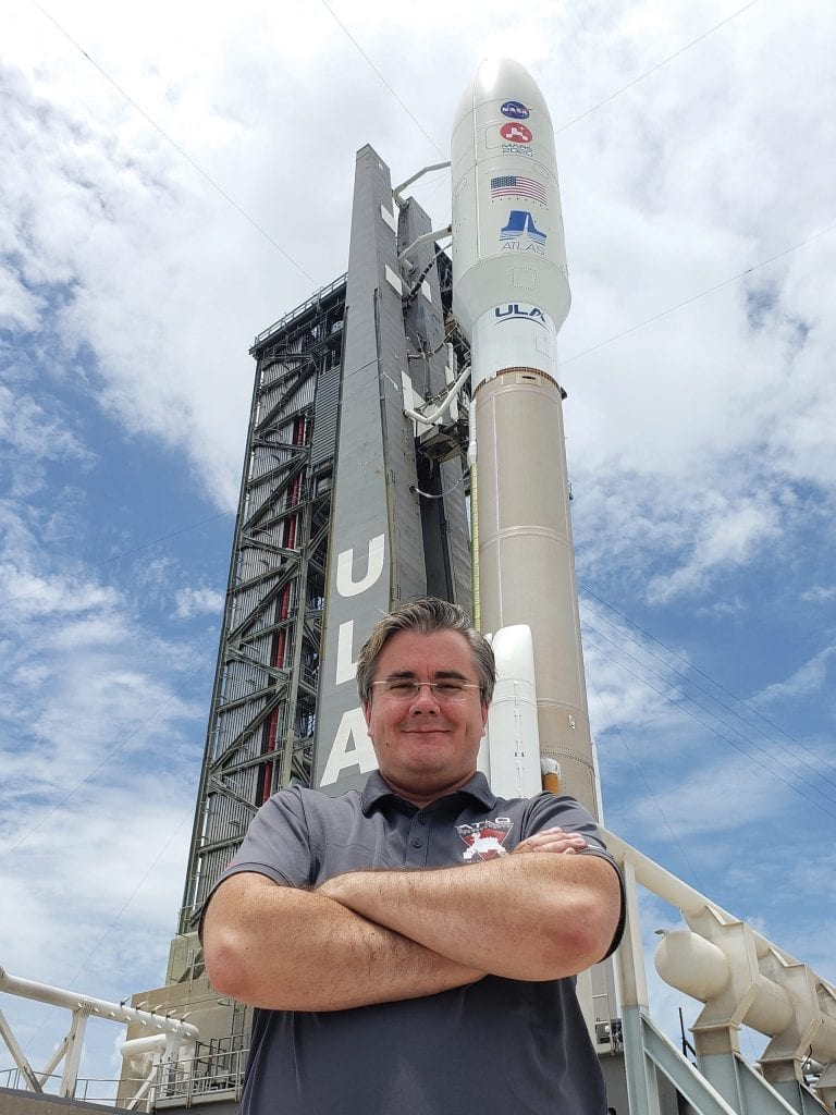 David Gruel stands next to the launchpad