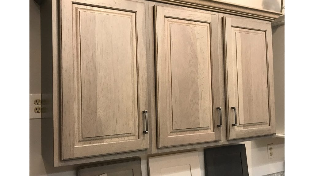 Colors such as gray translucent stain are appearing in more kitchens.