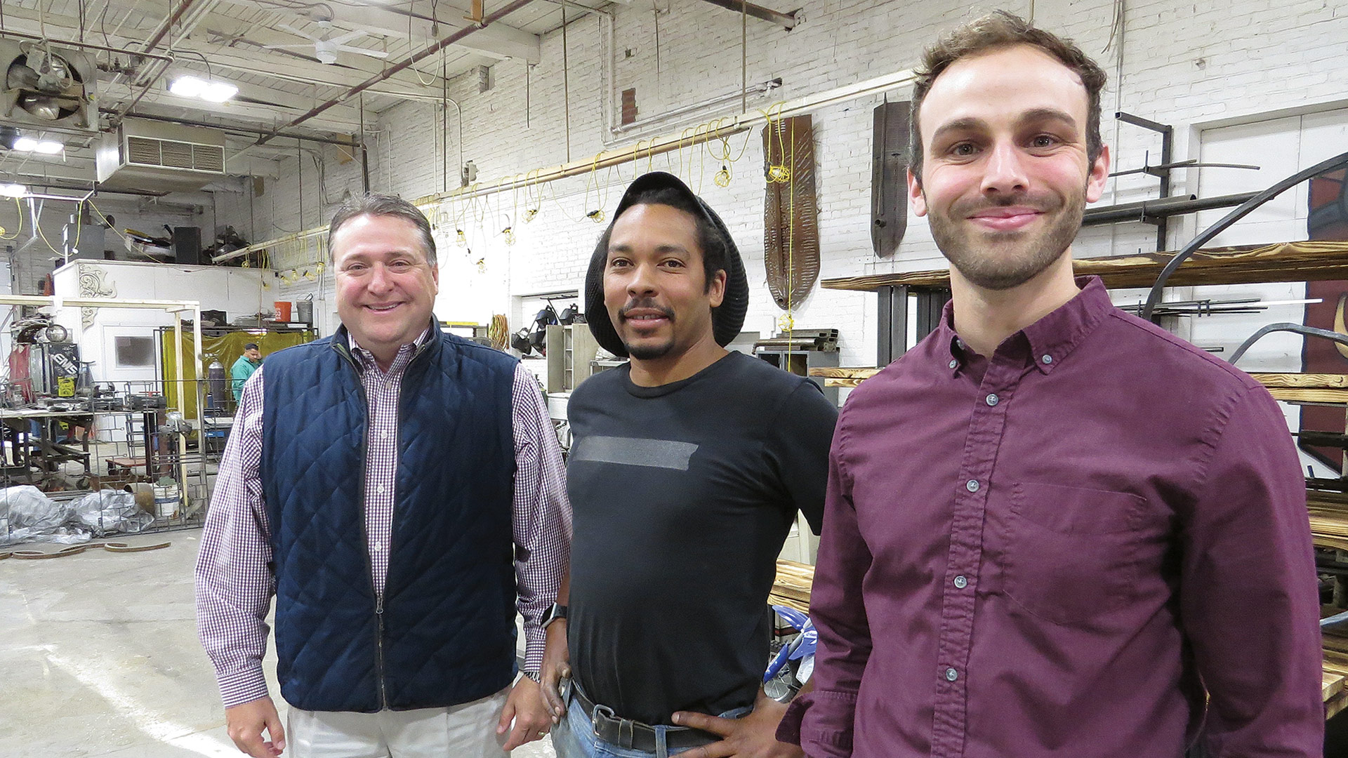 WestMass CEO Jeff Daley (left) and Sean O'Donnell (right), the agency's Economic Development planner and leasing manager, with metal sculptor Kamil Peters, who relocated to Ludlow Mills last summer.