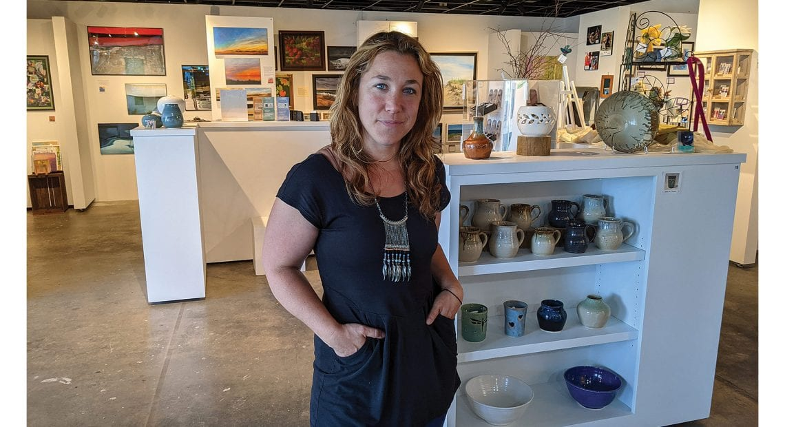 Hannah Rechtschaffen, director of placemaking for the Mill District and manager of Hannah's Local Art Gallery.