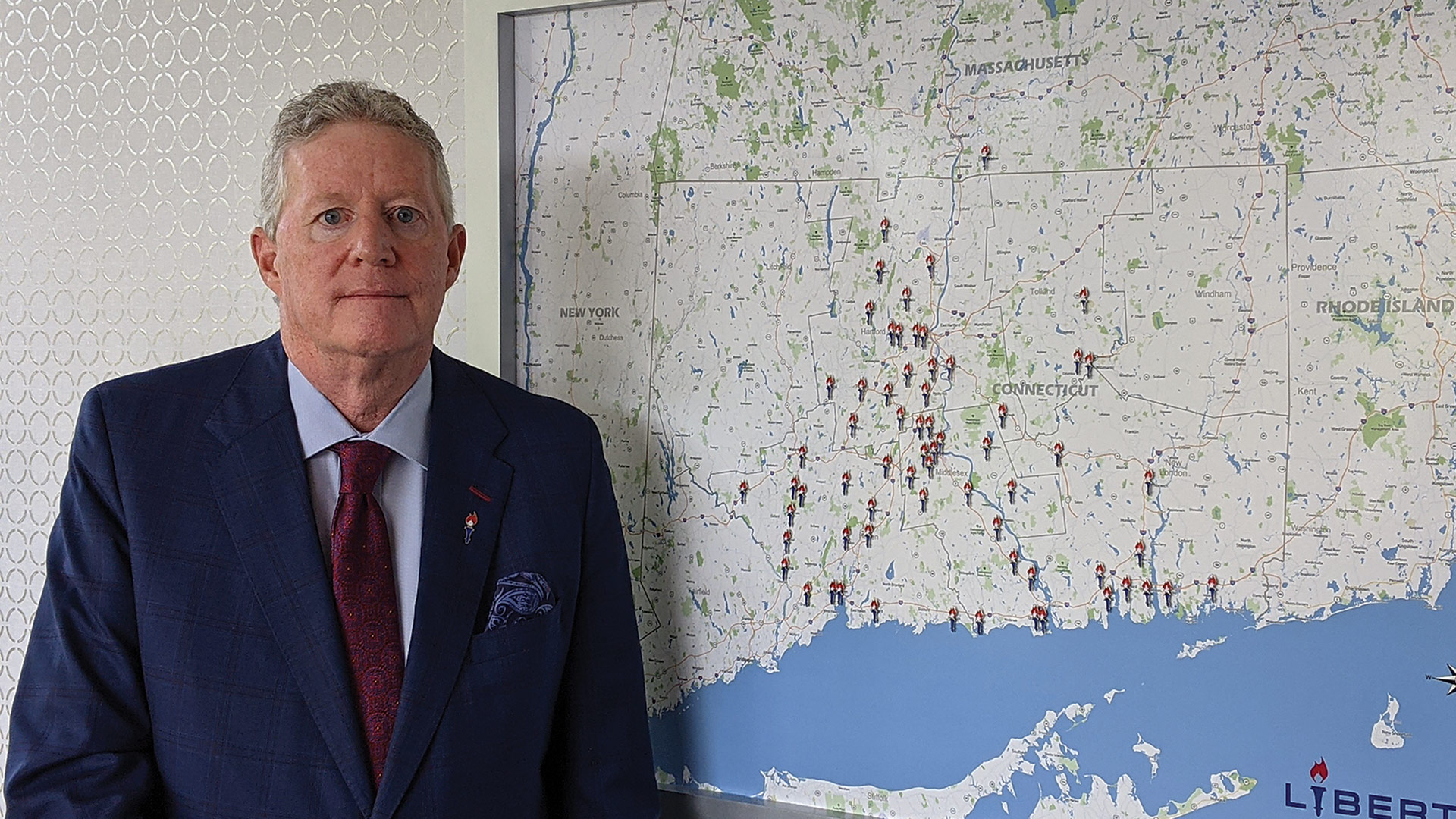Dave Glidden with a map of Liberty's locations