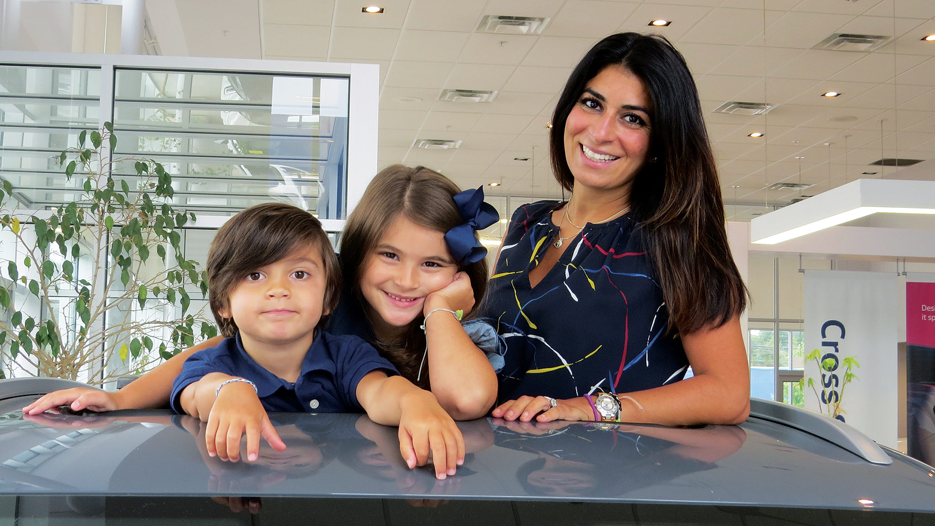Carla Cosenzi (with her kids, Nico and Talia) is among many dealers expecting a return to something approaching normal by next spring.