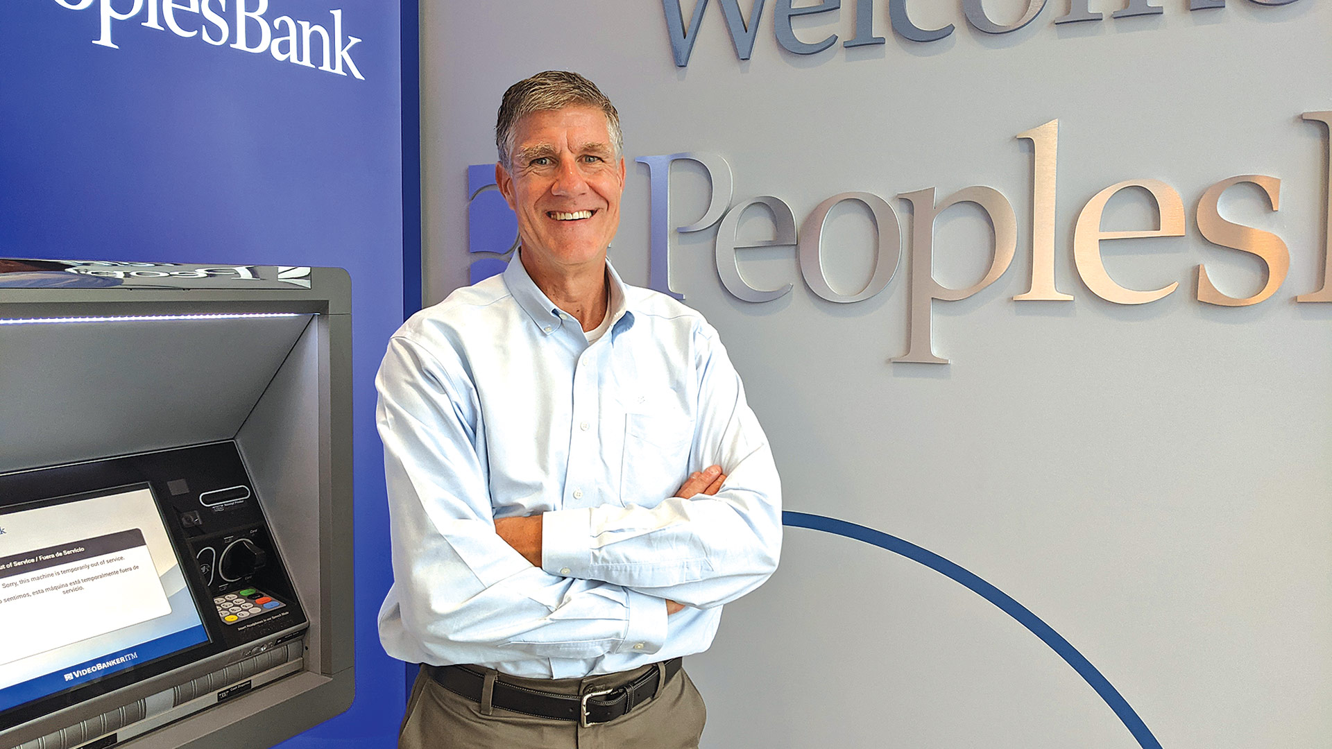 Matt Bannister with one of the West Hartford branch's two interactive video teller machines.