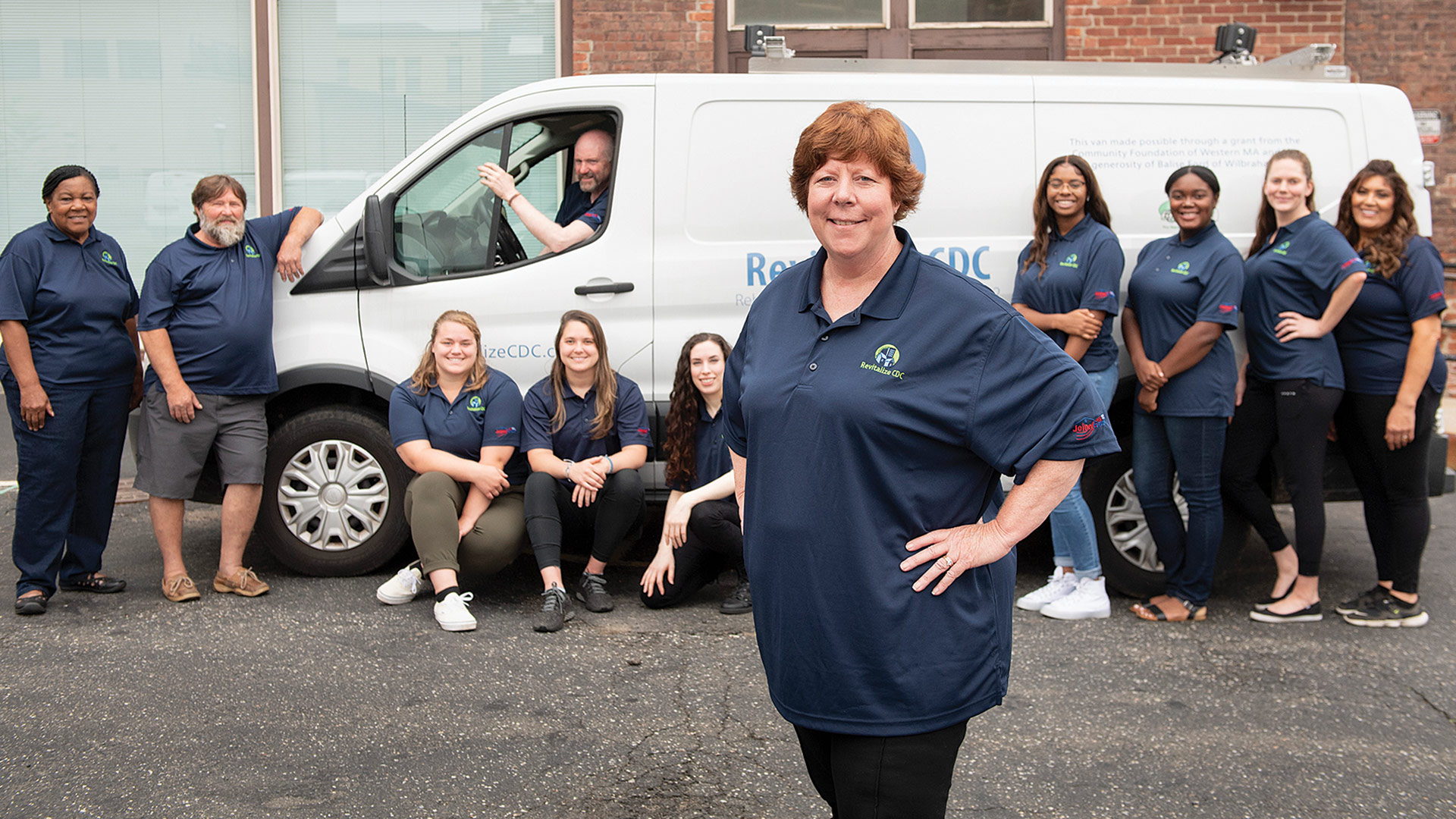 By partnering with health-centric organizations, Colleen Loveless (center) and Revitalize CDC was able to infuse its home-rehab efforts with a focus on wellness.