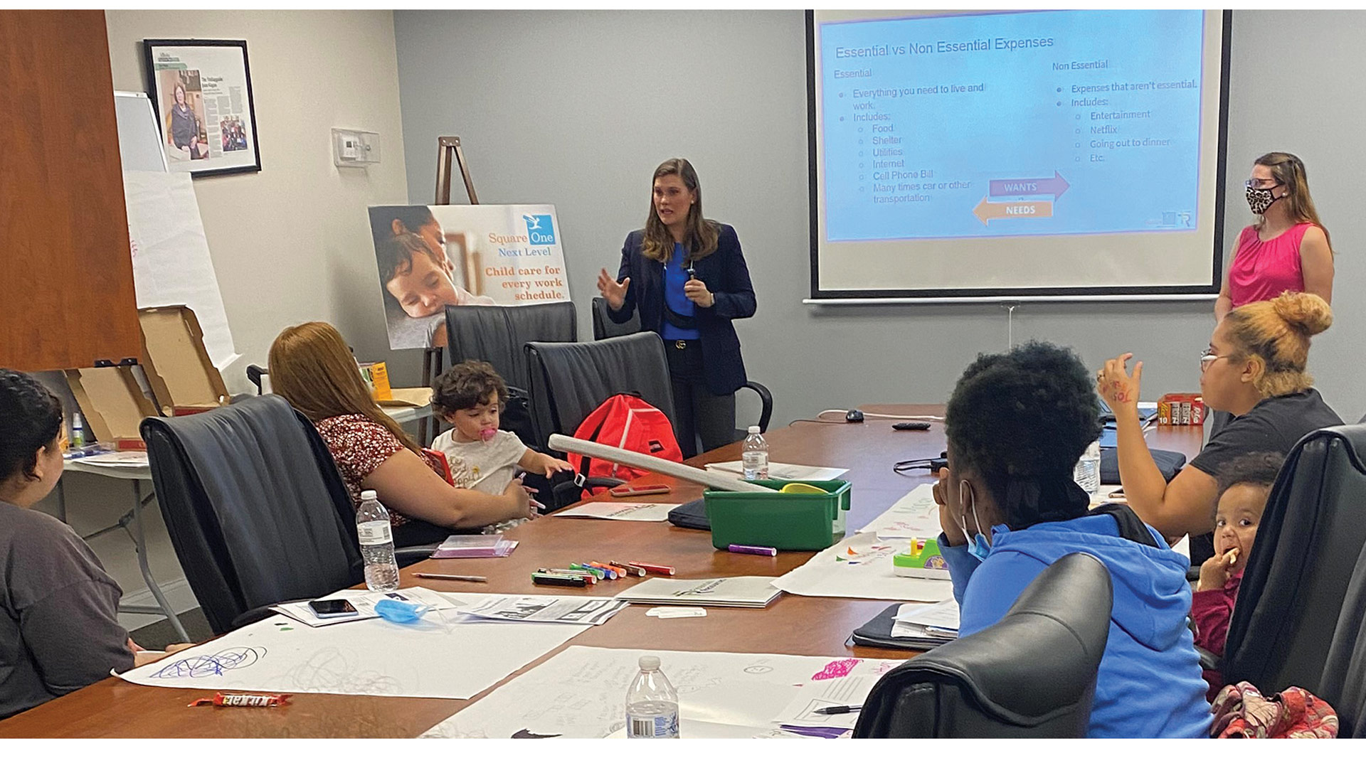 Flavia McCaughey leads a financial-literacy session at Square One.